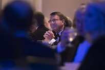 Defense Secretary Ash Carter, center, listens as Retired Air Force Gen. Norton A. Schwartz, President & Chief Executive Officer for the Business Executives for National Security, delivers remarks at the BENS Eisenhower Award dinner in Washington D.C., Apr. 28, 2016. Carter was presented with the 2016 Eisenhower Award. DoD photo by Senior Master Sgt. Adrian Cadiz