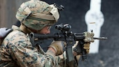 U.S. Marine Corps Lance Cpl. John Brancifort, a rifleman with Special Purpose Marine Air-Ground Task Force-Crisis Response-Africa, fires an M4 carbine in the lateral movement portion of a stress shooting exercise held by U.S. Army Special Forces in Germany, Apr. 12, 2016. The Marines ran through a timed firing course filled with flash-bang grenades and challenging shooting positions to put their marksmanship skills to the test in a stressful environment.