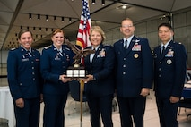 Left to right: Cadet 1st Class Bailee Harnett; Cadet 2nd Class Madison Martin; U.S. Air Force Academy Superintendent Lt. Gen. Michelle Johnson; Commandant of Cadets Brig. Gen. Stephen Williams; and Maj. Martin Poon, air officer commanding for Cadet Squadron 15, show-off the trophy cadets earned for winning the Great American Can Roundup's Commander in Chief's Challenge, a presidential recycling competition, April 27, 2016 in Mitchell Hall. In all, 4,050 cadets recycled 20,300 cans to beat-out Army and Navy in the challenge. (U.S. Air Force photo/Liz Copan)