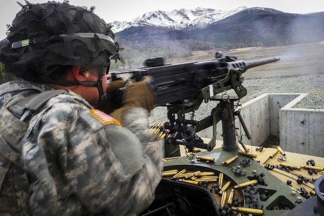 Army Spc. Dillon Weitzel fires at targets on a machine gun range at Joint Base Elmendorf-Richardson, Alaska, April 26, 2016. Weitzel is a paratrooper assigned to the 25th Infantry Division's 40th Cavalry Regiment, 4th Brigade Combat Team (Airborne), Alaska. Air Force photo by Justin Connaher