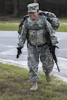 Army Reserve Spc. Kayla Bundy, a wheeled vehicle mechanic with the 1st Battalion, 414th Infantry Regiment, 95th Training Division, turns a corner at the halfway point of the 10-mile forced march during the 2016 108th Training Command Best Warrior competition at Fort Jackson, S.C., March 22, 2016. Army photo by Sgt. 1st Class Brian Hamilton