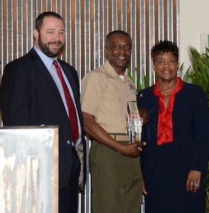 Col. James C. Carroll III, commanding officer, Marine Corps Logistics Base Albany, accepts the 2016 Only One Albany Industry Award from the Albany-Dougherty Economic Development Commission during a special Rise-n-Shine breakfast honoring local industries and hosted by the Albany Area Chamber of Commerce, recently.