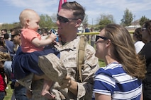 Cpl. John Sherriffs, rifleman, 1st Battalion, 7th Marine Regiment, greets his 7-month-old daughter, April, during the battalion's homecoming at Del Valle Field April 23, 2016. 1/7 was deployed as part of Special Purpose Marine Air Ground Task Force-Crisis Response-Central Command 16.1. (Official Marine Corps photo by Cpl. Medina Ayala-Lo/Released)