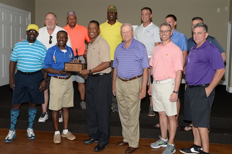 The Marine Corps Logistics Base Albany combined team represents the base during the bi-annual Salty Sandbagger Golf Tournament hosted by the Albany Area Chamber of Commerce's Military Affairs Committee, April 25.  MCLB Albany won the tournament with a score of 18.5 to 8.5.