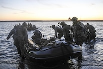 Marines carry a combat raiding craft into the water to conduct beach searches during an amphibious operations training exercise at Camp Pendleton, Calif., April 21, 2016. Marine Corps Photo by Cpl. Demetrius Morgan