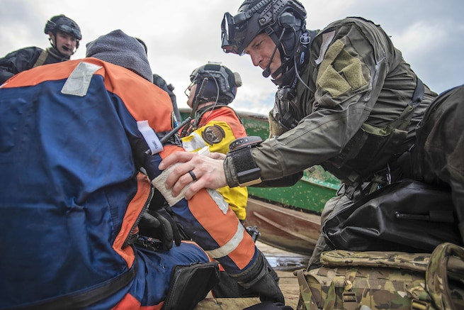 Airmen take part in a simulated casualty evacuation training exercise off the coast of Homer, Alaska., April 27, 2016. The scenario involved an injured member of a fishing vessel who required immediate treatment and extraction from the boat. The airmen are assigned to the Alaska Air National Guard. Air National Guard photo by Staff Sgt. Edward Eagerton