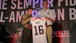 Drill instructor Sgt. Matthew Lee presents Jared Goff with his Semper Fidelis All-American Bowl jersey at a banquet Jan. 3, 2013. More than 100 athletes were selected to participate in the event. The Los Angeles Rams drafted Goff with the number one pick in the 2016 NFL draft, April 28, 2016.