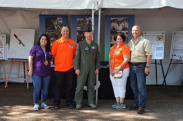 From left: Amber Lamm, JBSA community planner, Bryan Hummel, JBSA pollution prevention manager and aquifer recharge specialist, Lt. Col. Emil Bliss, 12th Flying Training Wing Community Initiatives director, Meg Reyes, director of JBSA installation encroachment and compatible development, and Monte Cox, a contracted community planning liaison. The group presented as one of the exhibitors at Earth Day Texas, an annual event supporting environmental conservation and education in Texas.