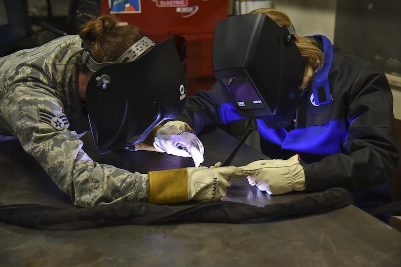 Air Force Secretary Deborah Lee James, right, completes a welding project April 27, 2016, at Fairchild Air Force Base, Wash., under the supervision of Senior Airman Mary Cannon, a 92nd Maintenance Squadron metals technology journeyman. James visited the base to familiarize herself with the missions of the 92nd and 141st Air Refueling Wings and 336th Training Group. (U.S. Air Force photo/Airman 1st Class Mackenzie Richardson)