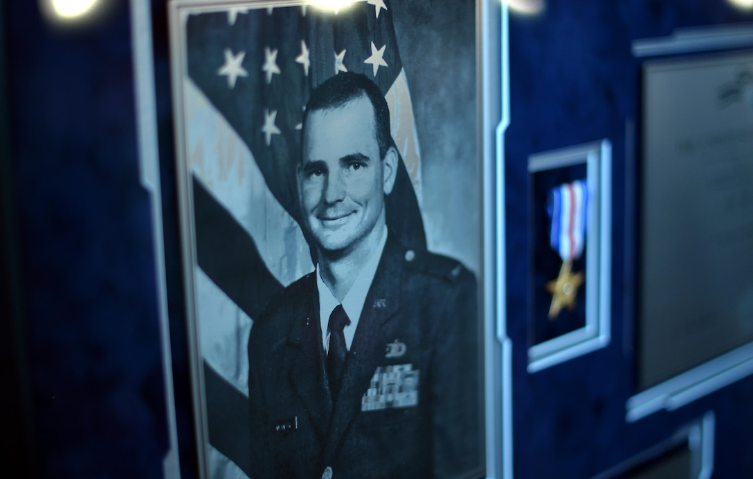Pictured is a plaque of fallen weather warrior U.S. Air Force Capt. Nathan Nylander. They 557th Weather Wing hosted a remembrance ceremony for him April 27, 2016 in their auditorium. (U.S. Air Force photo by Josh Plueger)
