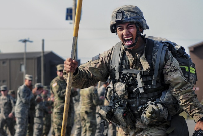 Army Sgt. Genaro Bueno completes the final portion of a 12-mile ruck march at Warrior Base near Panmunjeom, South Korea, April, 29, 2016. The ruck march was conducted as the final event during the Expert Field Medical Badge training event. Bueno is assigned to the 65th Medical Brigade. Army photo by Pfc. Lee, Kyeong-min