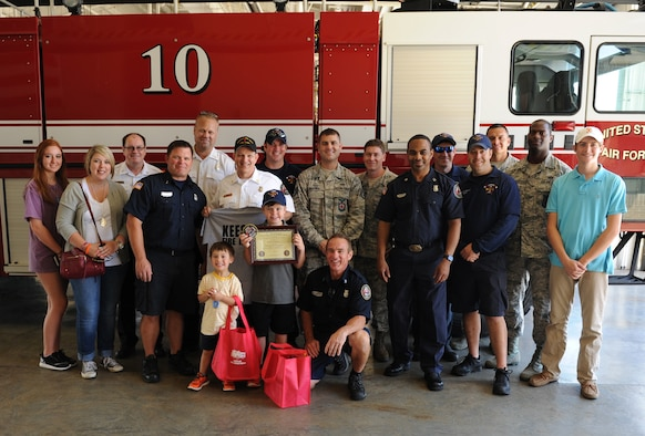 "Jon Bryant ""JB"" Orso poses for a photo while touring the Keesler Fire Department during the 403rd Wing's first Pilot for a Day event April 26, 2016, Keesler Air Force Base, Miss. Orso, who served as an honorary Air Force Reserve second lieutenant, is in remission after receiving treatment for Acute Lymphoblastic Leukemia. Pilot for a Day is a community outreach program for children with a chronic or life-threatening disease or illness. (U.S. Air Force photo by Kemberly Groue)"