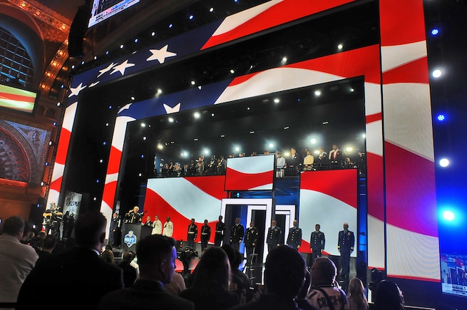 Local service members are recognized on stage during the first day of the NFL Draft in Chicago, April 28, 2016. Service members, from each branch of service, participated in the opening ceremony to include Army Staff Sgt. Ian Bowling, U.S. Army Field Band, who sang the National Anthem and the Army Reserve's 85th Support Command presenting the colors during the playing of the National Anthem.