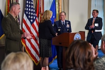 Defense Secretary Ash Carter, right, and Marine Corps Gen. Joe Dunford, left, chairman of the Joint Chiefs of Staff, applaud as Air Force Secretary Deborah Lee James shakes hands with Air Force Vice Chief of Staff Gen. David L. Goldfein during an event at the Pentagon April 29, 2016, following Goldfein's nomination as Air Force chief of staff. DoD photo by Army Sgt. 1st Class Clydell Kinchen