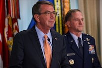 Defense Secretary Ash Carter delivers remarks during an event congratulating Air Force Vice Chief of Staff Gen. David L. Goldfein, right, following his nomination to be the next Air Force chief of staff at the Pentagon, April 29, 2016. DoD photo by Army Sgt. 1st Class Clydell Kinchen
