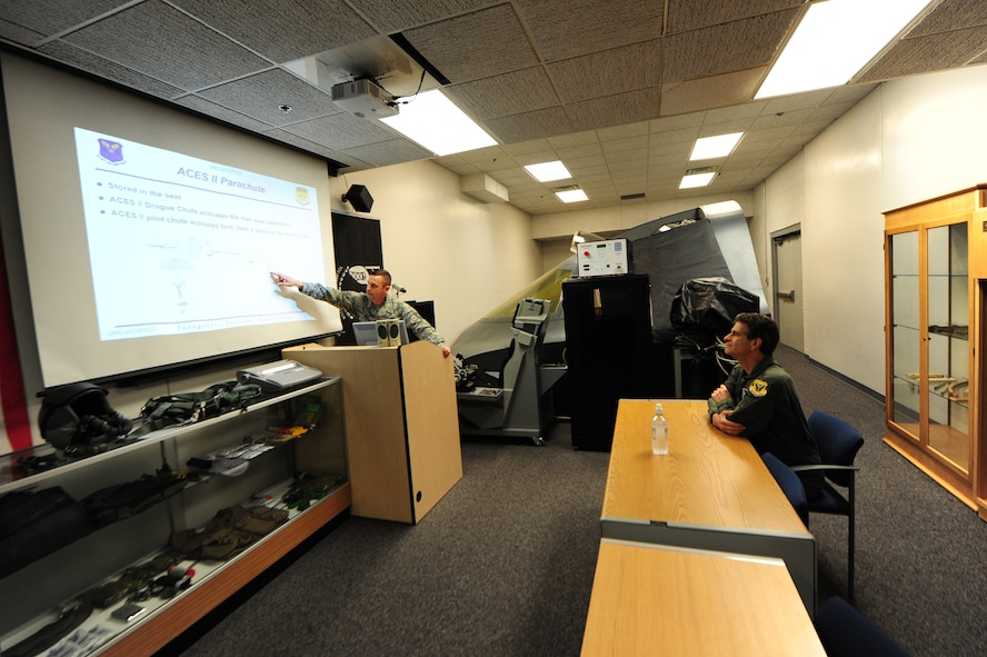 U.S. Air Force Tech. Sgt. Joshua Riffe, a 509th Operation Support Squadron aircrew flight equipment supervisor, left, details aircrew procedures to Dean Kamen, the FIRST Robotics founder, at Whiteman Air Force Base, Mo., April 26, 2016. Kamen met Airmen and FIRST Robotics alumni during his visit and received an incentive flight in a B-2 Spirit. The U.S. Air Force and FIRST Robotics share an interest in developing youth into future leaders through exposure to education in science, technology, engineering and mathematics. (U.S. Air Force photo by Airman 1st Class Keenan Berry)