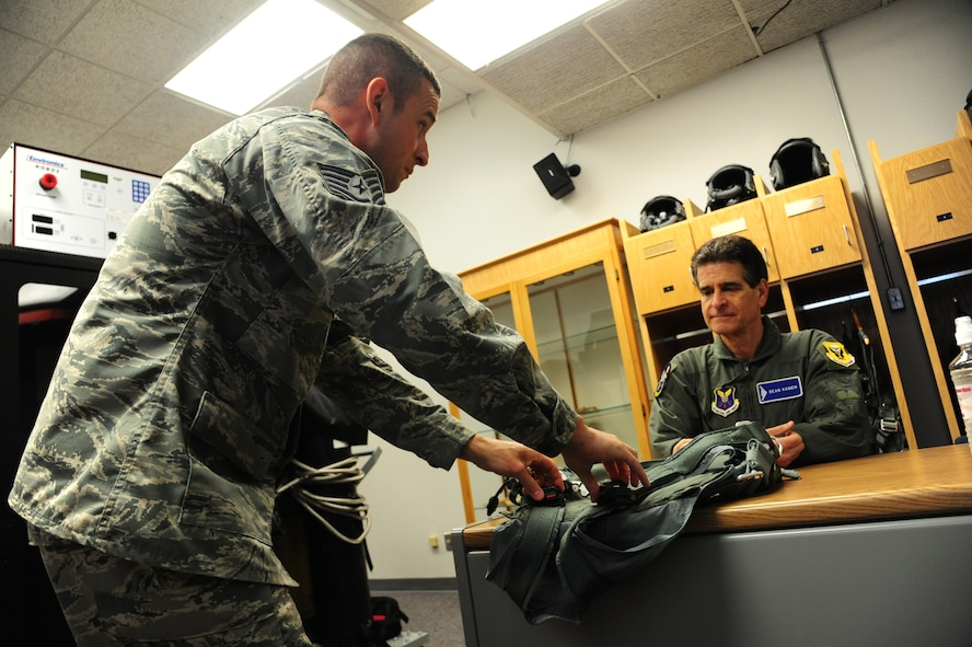 U.S. Air Force Tech. Sgt. Joshua Riffe, a 509th Operation Support Squadron aircrew flight equipment supervisor, left, explains features on a PCU-15/P torso harness to Dean Kamen, the FIRST Robotics founder, at Whiteman Air Force Base, Mo., April 26, 2016. Kamen met Airmen and FIRST Robotics alumni during his visit and received an incentive flight in a B-2 Spirit. The U.S. Air Force and FIRST Robotics share an interest in developing youth into future leaders through exposure to education in science, technology, engineering and mathematics. (U.S. Air Force photo by Airman 1st Class Keenan Berry)