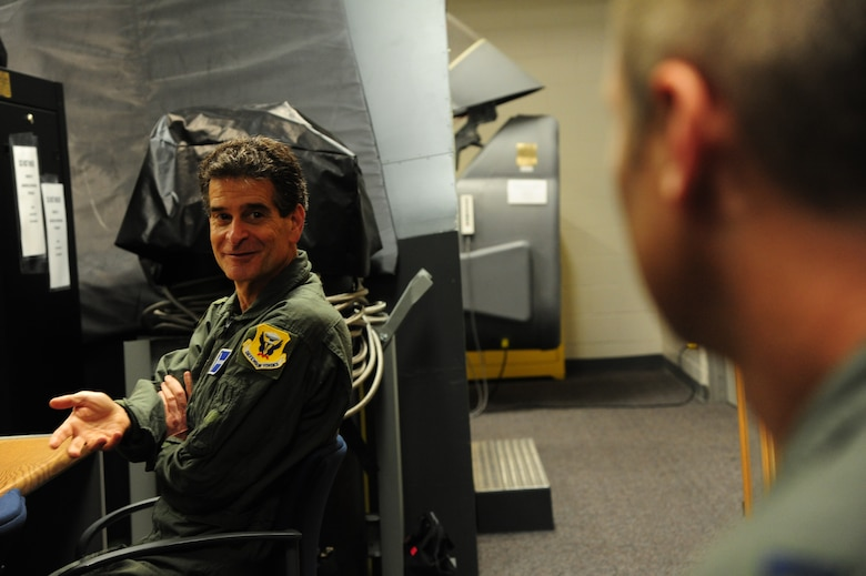 Dean Kamen, the FIRST Robotics founder, left, speaks with U.S. Air Force Capt. Ryan Magner, a 509th Operations Support Squadron B-2 Spirit pilot, about B-2 egress procedures at Whiteman Air Force Base, Mo., April 26, 2016. Kamen met Airmen and FIRST Robotics alumni during his visit and received an incentive flight in a B-2 Spirit. The U.S. Air Force and FIRST Robotics share an interest in developing youth into future leaders through exposure to education in science, technology, engineering and mathematics. (U.S. Air Force photo by Airman 1st Class Keenan Berry)
