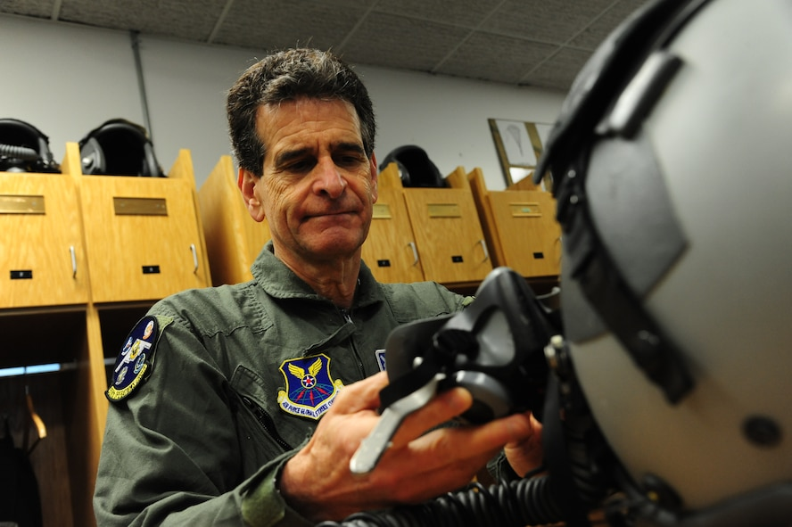 Dean Kamen, the FIRST Robotics founder, examines an MBU-20/P oxygen mask and an HGU-55/P flyer's helmet at Whiteman Air Force Base, Mo., April 26, 2016. Kamen met Airmen and FIRST Robotics alumni during his visit and received an incentive flight in a B-2 Spirit. The U.S. Air Force and FIRST Robotics share an interest in developing youth into future leaders through exposure to education in science, technology, engineering and mathematics. (U.S. Air Force photo by Airman 1st Class Keenan Berry)