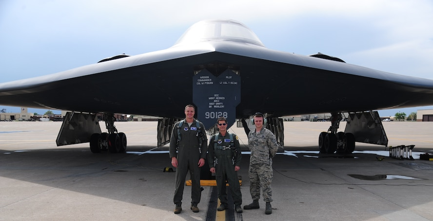 U.S. Air Force Capt. Daniel St. Clair, a B-2 Spirit pilot and FIRST Robotics alumni, left, Dean Kamen, FIRST Robotics founder, center, and U.S. Air Force Staff Sgt. Stephan Kuipers, a 509th Maintenance Squadron crew chief and FIRST Robotics alumni (right), pose in front of a B-2 Spirit at Whiteman Air Force Base, Mo., April 26, 2016. The U.S. Air Force and FIRST Robotics share an interest in developing youth into future leaders through exposure to education in science, technology, engineering and mathematics. (U.S. Air Force photo by Senior Airman Joel Pfiester)