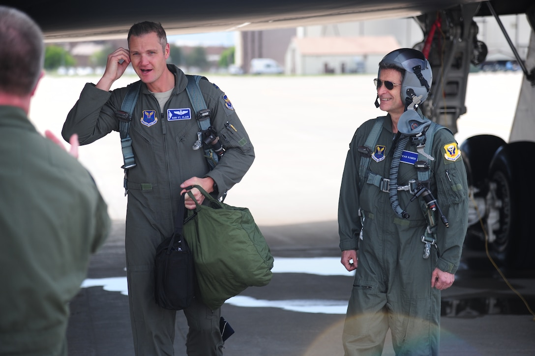 U.S. Air Force Capt. Daniel St. Clair, a B-2 Spirit pilot and FIRST Robotics alumni, left, and Dean Kamen, FIRST Robotics founder, right, exit from a B-2 at Whiteman Air Force Base, Mo., April 26, 2016. Kamen met with Airmen during a tour of Whiteman and also received an incentive flight in a B-2. (U.S. Air Force photo by Senior Airman Joel Pfiester)