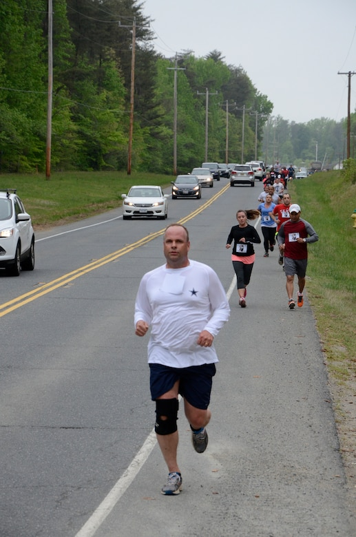Brig. Gen. Keith M. Givens, Air Force Office of Special Investigations Commander,  leads a group of runners on the return leg of the 3rd Annual Hero Run April 27 at Marine Corps Base, Quantico, Va. The 2.7 mile event honors the memory of OSI member Master Sgt. Tara Brown who was killed, along with seven other courageous Airmen, by a gunman at Kabul International Airport April 27, 2011. (U.S. Air Force photo/Wayne Amann)