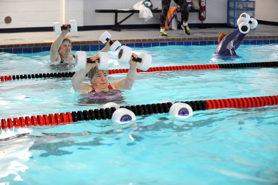 A group of seniors participates in a water aerobics class at the Robins Fitness Center, April 27, 2016. According to the Centers For Disease Control, water-based exercise can help people with chronic diseases like arthritis. It improves use of affected joints without worsening symptoms. (U.S. Air Force photo by Tommie Horton)