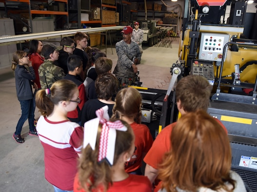 Students from Mansfield Elementary School learn about asphalt mixing from Senior Master Sgt. Robert Haag II, rapid engineer deployable heavy operational repair squadron engineer (REDHORSE) training center senior instructor, during their visit to the 188th Wing April 20, 2016, at Ebbing Air National Guard Base, Fort Smith, Ark. The students were shown careers in civil engineering, remotely piloted aircraft and security forces. (U.S. Air National Guard photo by Senior Airman Cody Martin/Released)
