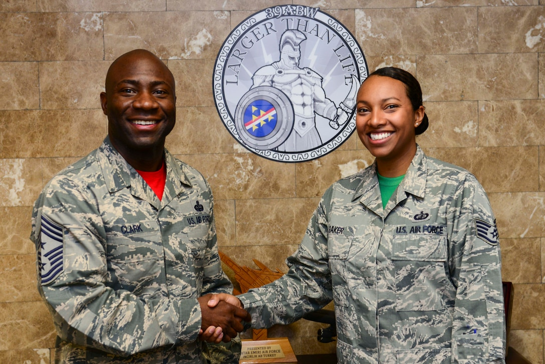Chief Master Sgt. Vegas Clark, 39th Air Base Wing command chief, stands with Staff Sgt. Chelsea Baker, 39th Contracting Squadron contract administrator, in the 39th ABW front office before beginning Baker's chief shadow day April 29, 2016. Airmen are chosen for the command chief's shadow program based on their commander's recommendation about their dedication to the mission. (U.S. Air Force photo by Staff Sgt. Caleb Pierce/Released)
