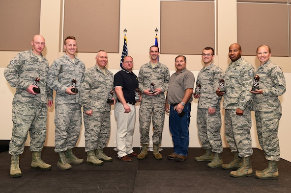 The 460th Space Wing first quarter award winners stand together April 28, 2016, at the Leadership Development Center on Buckley Air Force Base, Colo. The award winners were selected based on their hard work and dedication in their work centers. (U.S. Air Force photo by Senior Airman Racheal E. Watson/Released)