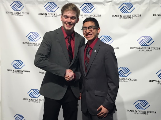 Ernesto Flores, 2016 Colorado Military Youth of the Year, shakes the hand of Clayton Starnes, 2016 Colorado State Youth of the Year, March 22, 2016, during the Colorado Youth of the Year Ceremony in Denver, Colo. The Youth of the Year program began in 1947 and is sponsored by the Boys and Girls Club to showcase the best and brightest youth from around the country. (Courtesy Photo)