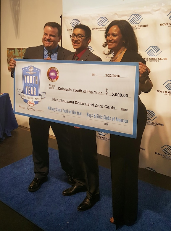 Ernesto Flores, 2016 Colorado Military Youth of the Year, is awarded a $5,000 scholarship March 22, 2016, during the Colorado Youth of the Year Ceremony in Denver, Colo. Ernesto will compete within the Southwest region this summer in hopes of winning more scholarships to help him attend the University of Texas. (Courtesy Photo)