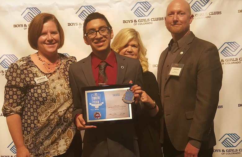 Ernesto Flores, 2016 Colorado Military Youth of the Year, receives a plaque March 22, 2016, during the Colorado Youth of the Year ceremony in Denver, Colo. The Youth of the Year program honors young people on their path to great futures and encourages all young adults to lead, succeed and inspire. (Courtesy Photo)