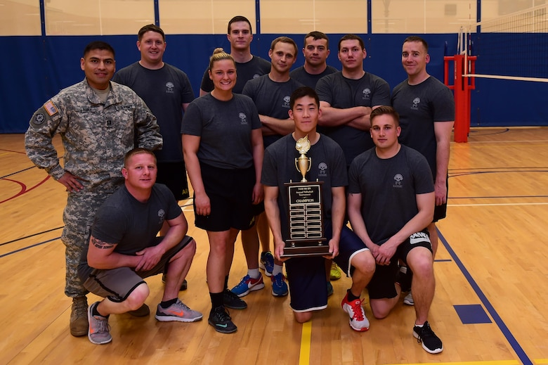 Members of the 743d Military Intelligence Battalion gather together after winning an annual volleyball tournament April 28, 2016, at the Buckley Fitness Center on Buckley Air Force Base, Colo. The tournament, a Commander's Cup event, provided bragging rights to the winning team and allowed participants the opportunity for inter-battalion competition. (U.S. Air Force photo by Airman 1st Class Gabrielle Spradling/Released)