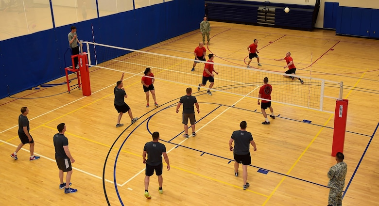 Members of the 743d Military Intelligence Battalion compete in an annual volleyball tournament April 28, 2016, at the Buckley Fitness Center on Buckley Air Force Base, Colo. Held over a two-day period, the tournament involved three teams and encouraged friendly inter-battalion competition. (U.S. Air Force photo by Airman 1st Class Gabrielle Spradling/Released)