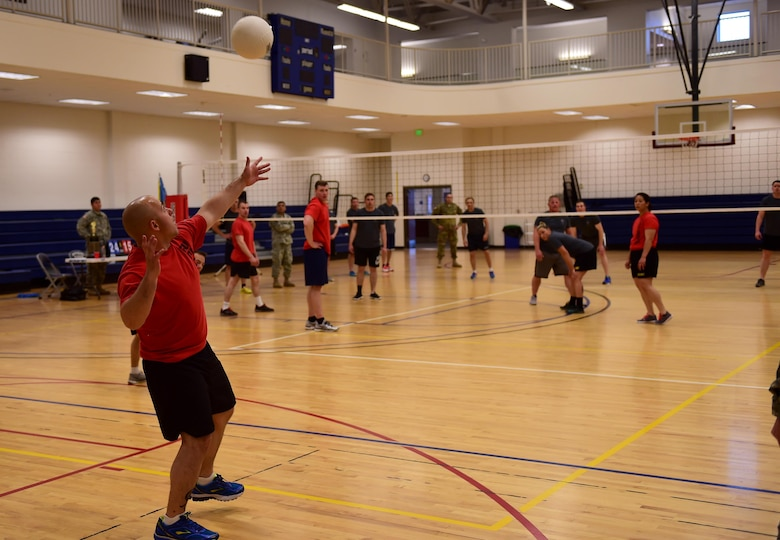 U.S. Army Sgt. Joseph Dechiara, 743d Military Intelligence Battalion signals analyst, prepares to serve a volleyball April 28, 2016, at the Buckley Fitness Center on Buckley Air Force Base, Colo. The tournament provided members a chance to boost esprit de corps and compete for Commander's Cup points. (U.S. Air Force photo by Airman 1st Class Gabrielle Spradling/Released)