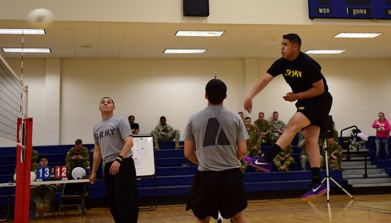 U.S. Army Pfc. Jonnathan Soto, 743d Military Intelligence Battalion S3 operations, hits a volleyball April 27, 2016, at the Buckley Fitness Center on Buckley Air Force Base, Colo. The tournament provided Commander's Cup points to the winning team and, at the end of the fiscal year, the company with most points wins a trophy and bragging rights.  (U.S. Air Force photo by Airman 1st Class Gabrielle Spradling/Released)