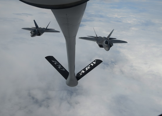 Two U.S. Air Force F-22 Raptors assigned to the 95th Fighter Squadron at Tyndall Air Force Base, Fla., fly in formation behind a 100th Air Refueling Wing KC-135 Stratotanker assigned to RAF Mildenhall, England April 27, 2016, in route to Šiauliai Air Base, Lithuania. The aircraft will conduct air training with other Europe-based aircraft, demonstrating the U.S. commitment to NATO allies and the security of Europe. (U.S. Air Force photo by Staff Sgt. Nathan Tucker/Released)