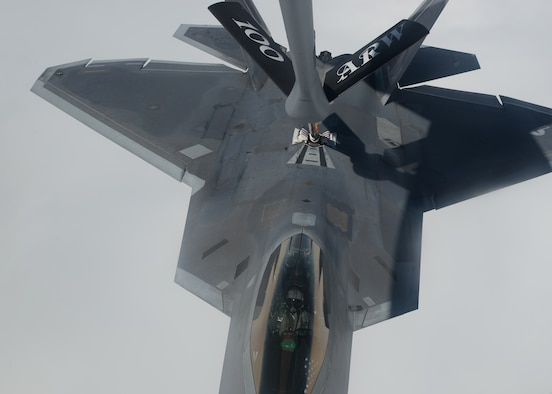 A U.S. Air Force F-22 Raptor assigned to the 95th Fighter Squadron at Tyndall Air Force Base, Fla., receives fuel from a 100th Air Refueling Wing KC-135 Stratotanker assigned to RAF Mildenhall, England, April 27, 2016, in route to Šiauliai Air Base, Lithuania. Both aircraft landed in Lithuania, demonstrating the U.S. commitment to NATO allies and the security of Europe. (U.S. Air Force photo by Staff Sgt. Nathan Tucker/Released)
