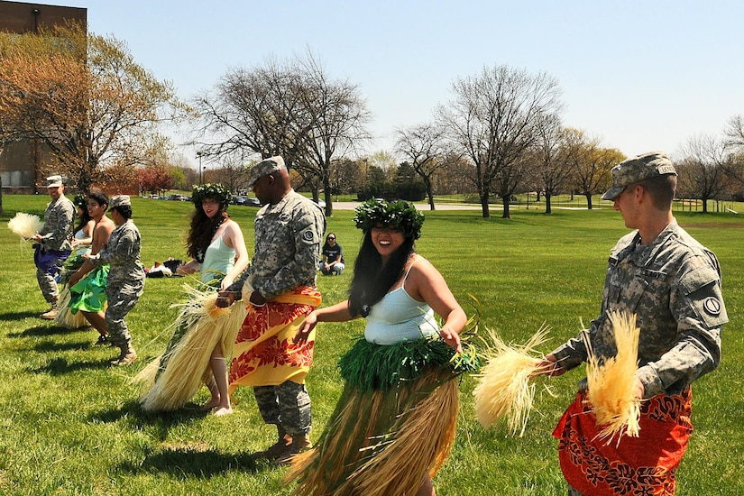 Army Reserve soldiers, from the 85th Support Command, dance with the Barefoot Hawaiian performing arts group during the command's Asian American and Pacific Islander Heritage month observance, May 2. (U.S. Army photo by Sgt. Aaron Berogan/Released)