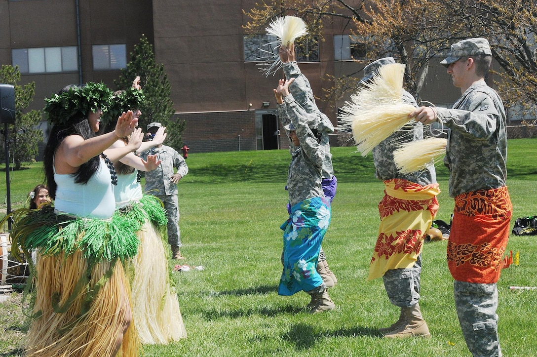 Army Reserve soldiers, from the 85th Support Command, dance with the Barefoot Hawaiian performing arts group during the command's Asian American and Pacific Islander Heritage month observance May 2. (U.S. Army photo by Spc. David Lietz/Released)