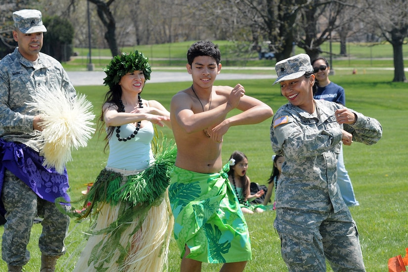 Lt. Col. Vickie Argueta, right, Equal Opportunity Advisor, 85th Support Command, dances with the Barefoot Hawaiian performing arts group during the command's Asian American and Pacific Islander Heritage month observance May 2. (U.S. Army photo by Spc. David Lietz/Released)