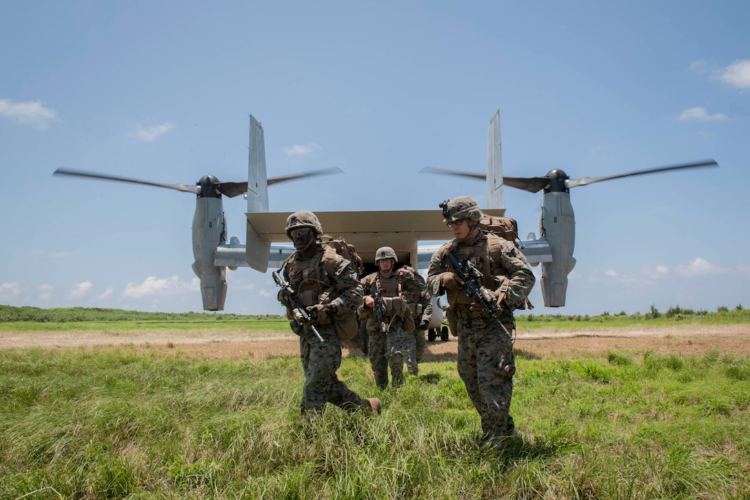 A U.S. Marine Corps MV-22 Osprey assigned to Marine Medium Tiltrotor Squadron 265, Marine Corps Air Station Futenma, Japan, drops off Marines assigned to Golf Company, 2nd Battalion, 2nd Marine Regiment, Marine Corps Base Camp Lejeune, N.C., during a long-range airfield seizure exercise July 20, 2016, at Iejima airfield, Japan. The Osprey can carry 24 combat troops, transport them with the speed and range of a fixed wing aircraft, and perform insertions or extractions with the maneuverability of rotor aircraft. (U.S. Air Force Photo by Senior Airman Peter Reft)