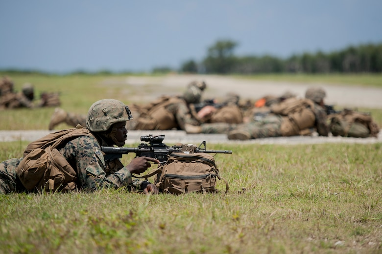 U.S. Marine Corps riflemen assigned to Golf Company, 2nd Battalion, 2nd Marine Regiment, Marine Corps Base Camp Lejeune, N.C., post a defensive perimeter during an airfield seizure exercise July 20, 2016, at Iejima airfield, Japan. Golf Company conducted their first long-range airfield seizure exercise with support from the Marine Medium Tiltrotor Squadron 265, Marine Corps Air Station Futenma, Japan and the U.S. Air Force 353rd Special Operations Group, Kadena Air Base, Japan. (U.S. Air Force Photo by Senior Airman Peter Reft)