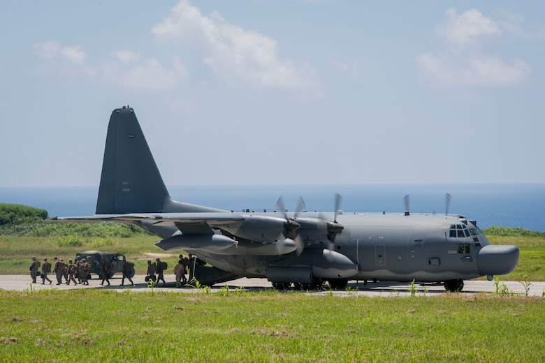 A U.S. Air Force MC-130H Combat Talon II assigned to the 17th Special Operations Squadron, Kadena Air Base, Japan, unloads U.S. Marines assigned to Golf Company, 2nd Battalion, 2nd Marine Regiment, Camp Lejeune, N.C., during a long-range airfield seizure July 20, 2016, at Iejima airfield, Japan. The Air Force and Marine Corps units combined forces in an exercise that helped build joint training relationships, enhancing interoperability of separate combat forces for contingency operations. (U.S. Air Force Photo by Senior Airman Peter Reft)