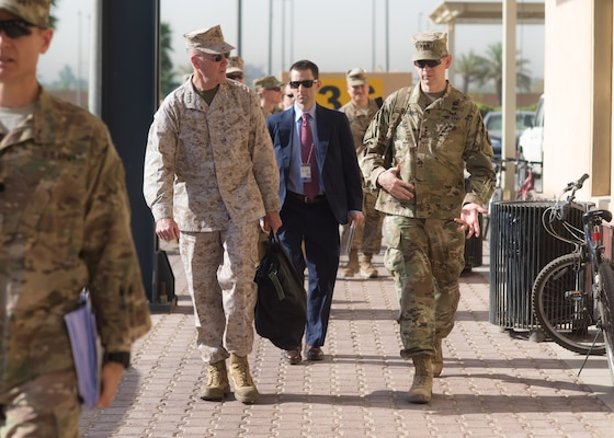 Marine Corps Gen. Joe Dunford, chairman of the Joint Chiefs of Staff, speaks to Army Lt. Gen. Sean MacFarland, commander of Combined Joint Task Force Operation Inherent Resolve, in Baghdad, July 31, 2016. Dunford is visiting Iraq to assess the campaign against the Islamic State of Iraq and the Levant. DoD Photo by Navy Petty Officer 2nd Class Dominique A. Pineiro