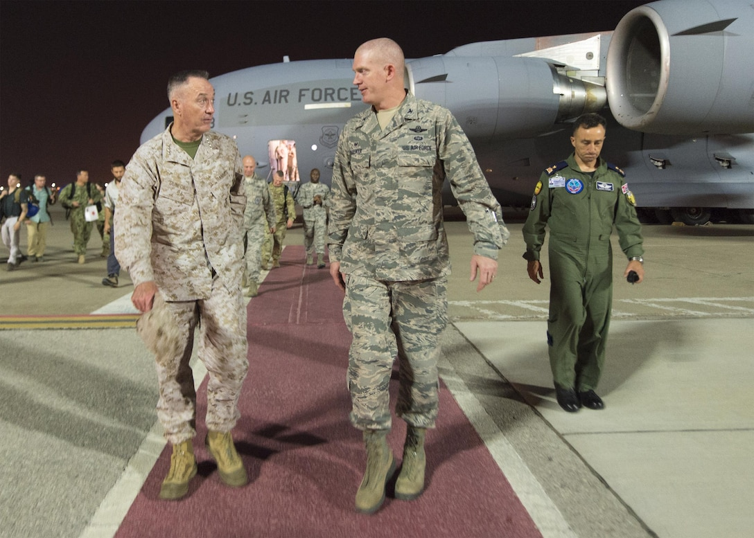 Marine Corps Gen. Joe Dunford, chairman of the Joint Chiefs of Staff, speaks with a member of the U.S. Air Force after arriving at Incirlik Air Base, July 31, 2016. DoD photo by Navy Petty Officer 2nd Class Dominique A. Pineiro
