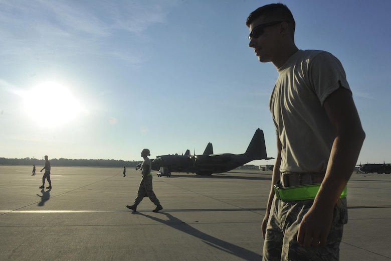 Air Commandos from the 4th Aircraft Maintenance Unit search for debris during a foreign object debris walk at Hurlburt Field, Fla., July 20, 2016. The performance of a FOD walk ensures no flightline debris causes damage to any aircraft. (U.S. Air Force photo by Airman Dennis Spain)