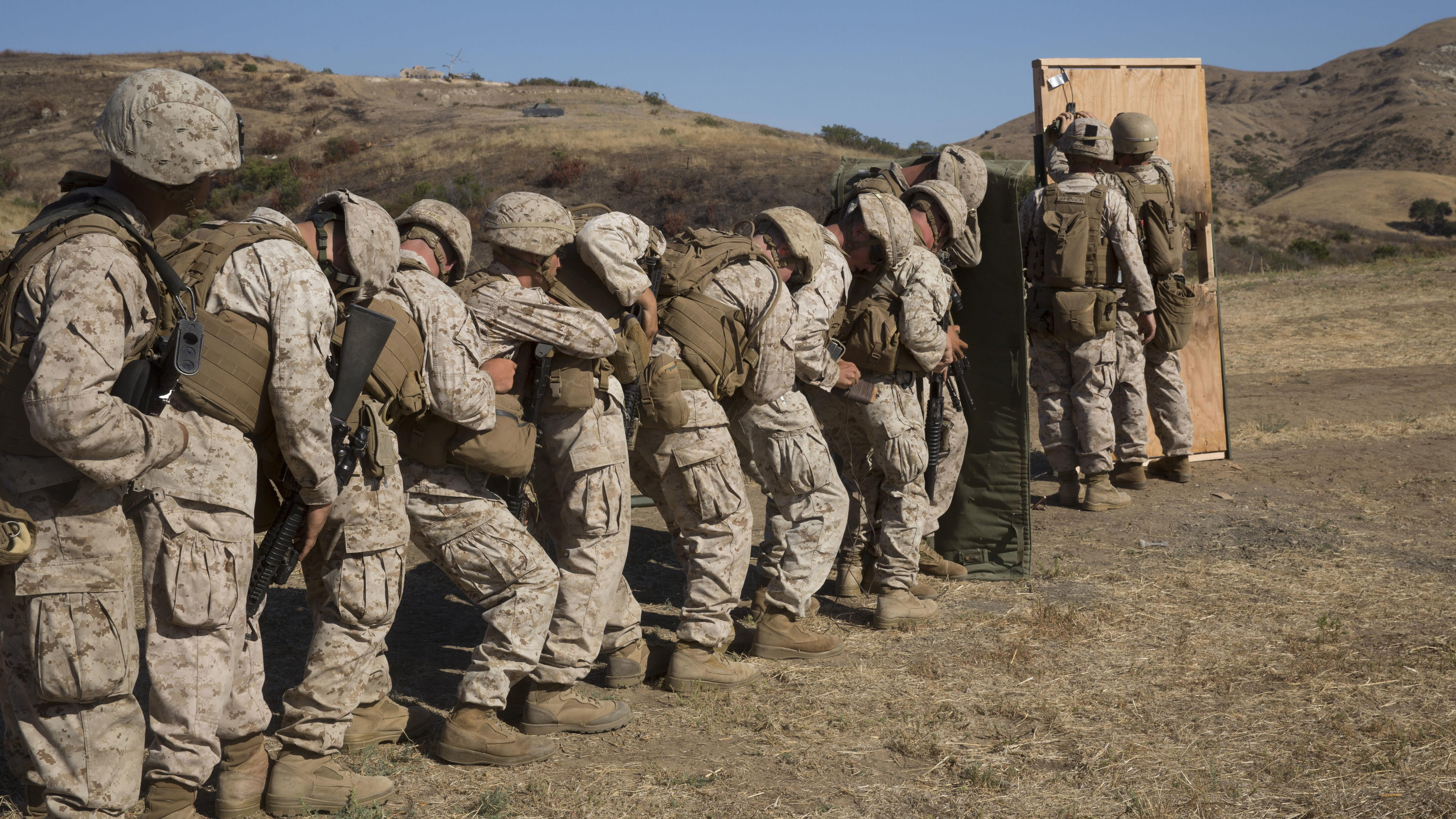 Marines from 1st Battalion 5th Marine Regiment 1st Marine Division stack up behind & Marines.mil - Photos