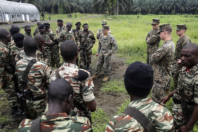 Marines with Special Purpose Marine Air-Ground Task Force Crisis Response-Africa, prepare to conduct practical application with Cameroonian soldiers with Forces Fusiliers Marins et Palmeurs de Combat on fire team formations and patrols in Limbé, Cameroon, June 27, 2016.  Marines share tactics, techniques and skills with the FORFUMAPCO soldiers to combat the illicit trafficking in Cameroon.  (U.S. Marine Corps photo by Cpl. Alexander Mitchell/released)